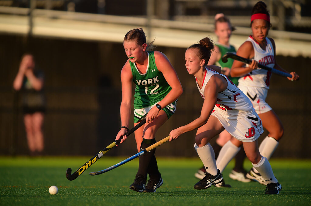 YCP field hockey player competes for the ball